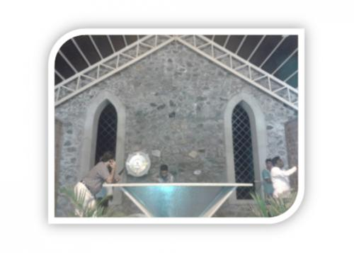 CHRUCH INSIDE ARCHIES ALONG WITH STONE WALL & GRANITE FRAMEING ALTER